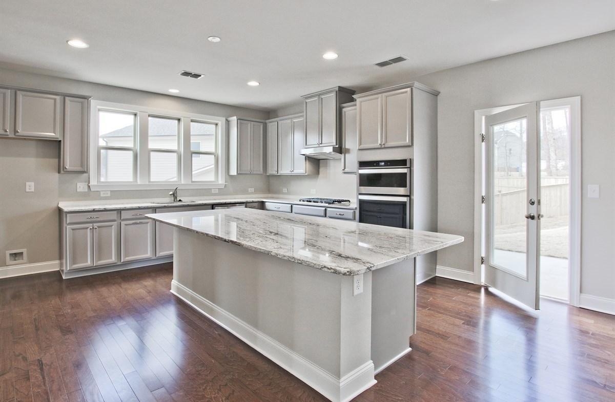 Amelia II quick move-in Kitchen with granite countertops