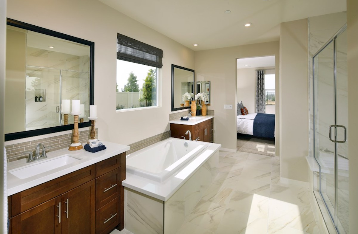 Solstice Alder Spa-inspired luxury abounds in the deluxe master bath, complete with separate shower and soaking tub