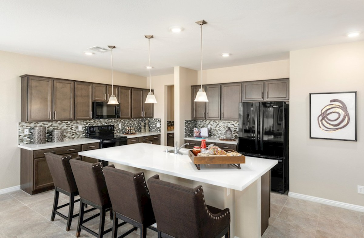 Burson Sienna kitchen features granite countertops in the Sienna model