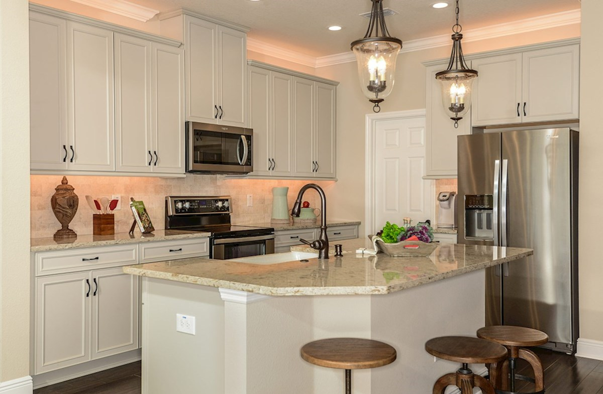 Avalon Park West Sea Breeze Kitchen with white cabinets and large center island