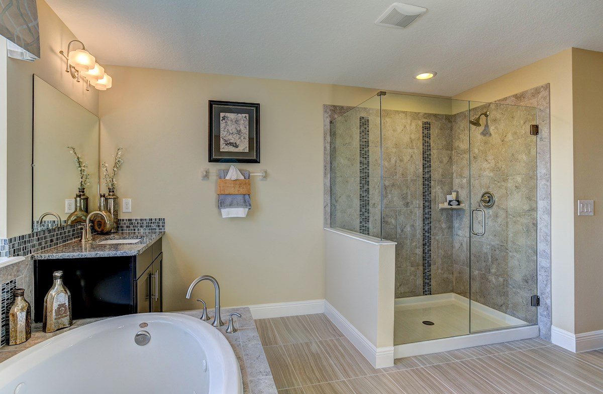 The Reserve at Pradera Sequoia Master bathroom with garden tub and glass enclosed shower