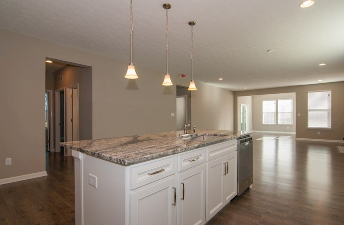 Heritage Trace Hamilton open concept kitchen and great room with hardwood floors