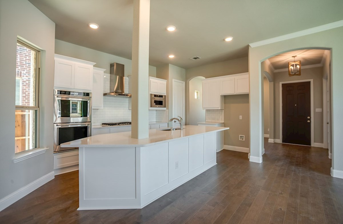 Eastland quick move-in kitchen features wood flooring