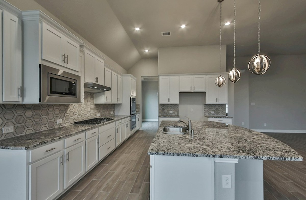 Caldwell quick move-in kitchen with granite countertops, tile flooring and stainless steel appliances