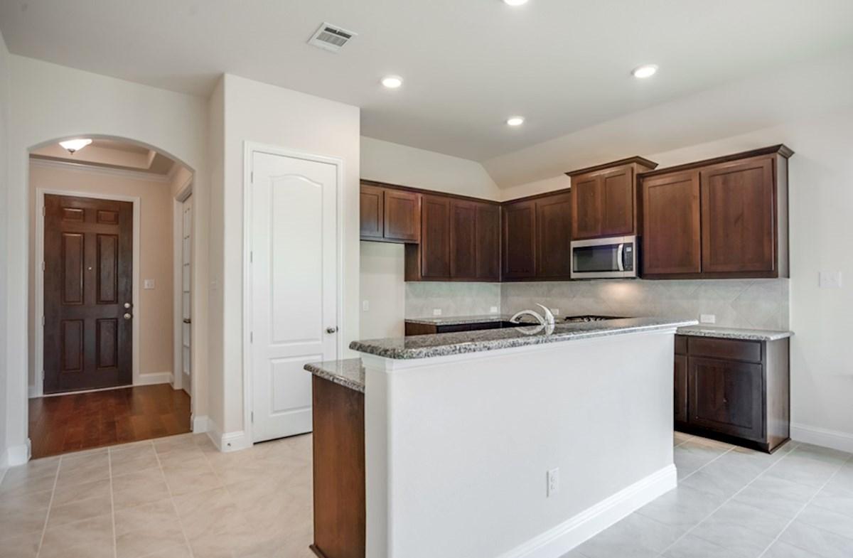 Silverado quick move-in Silverado open kitchen with dark cabinets and island