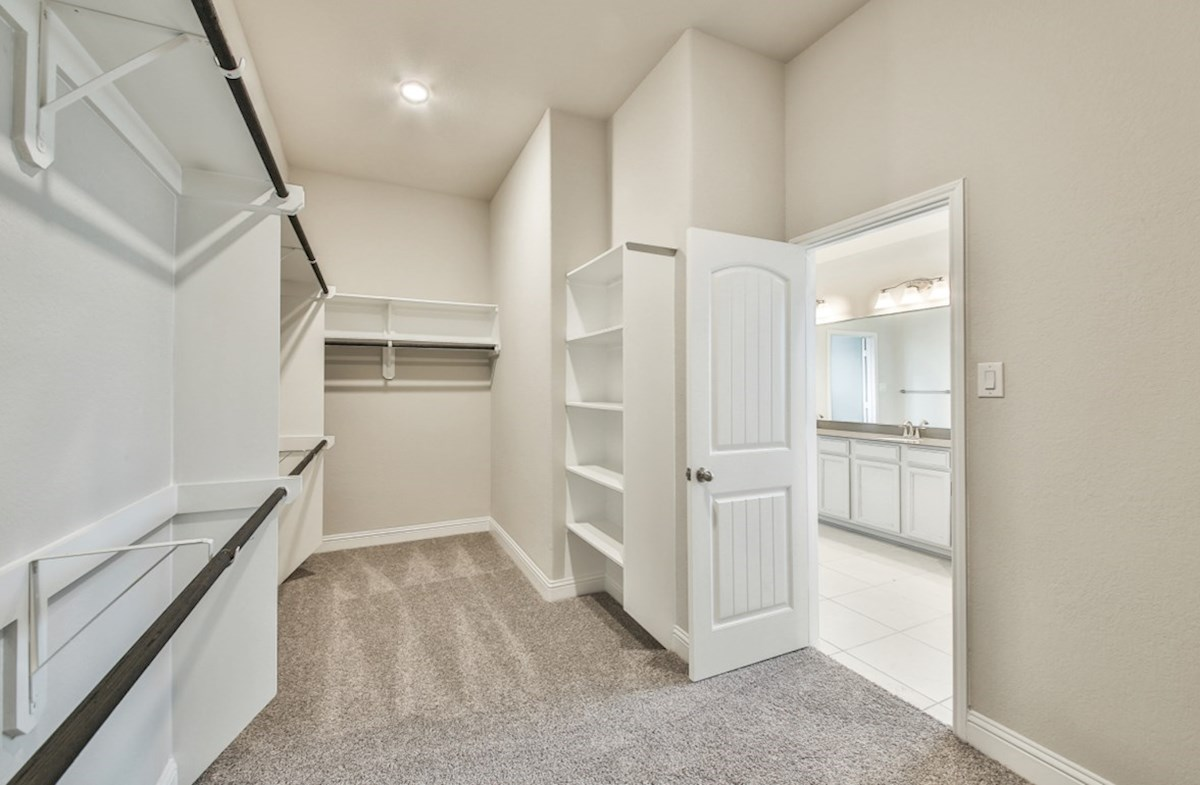 Bandera quick move-in master closet with built-in shelves