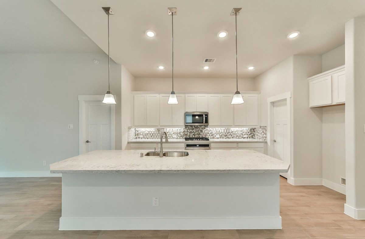 Reflection quick move-in kitchen with white cabinets and pendant lighting