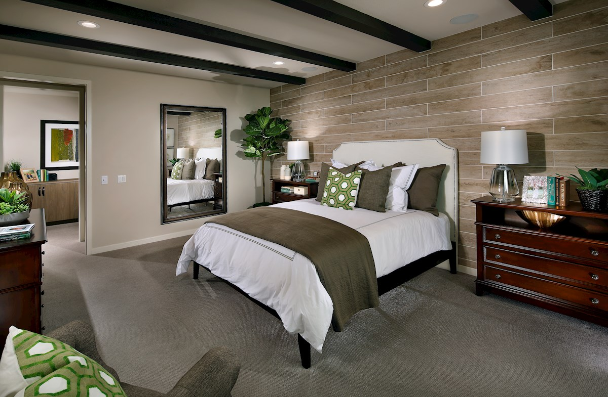Relax in the bright, spacious master bedroom.