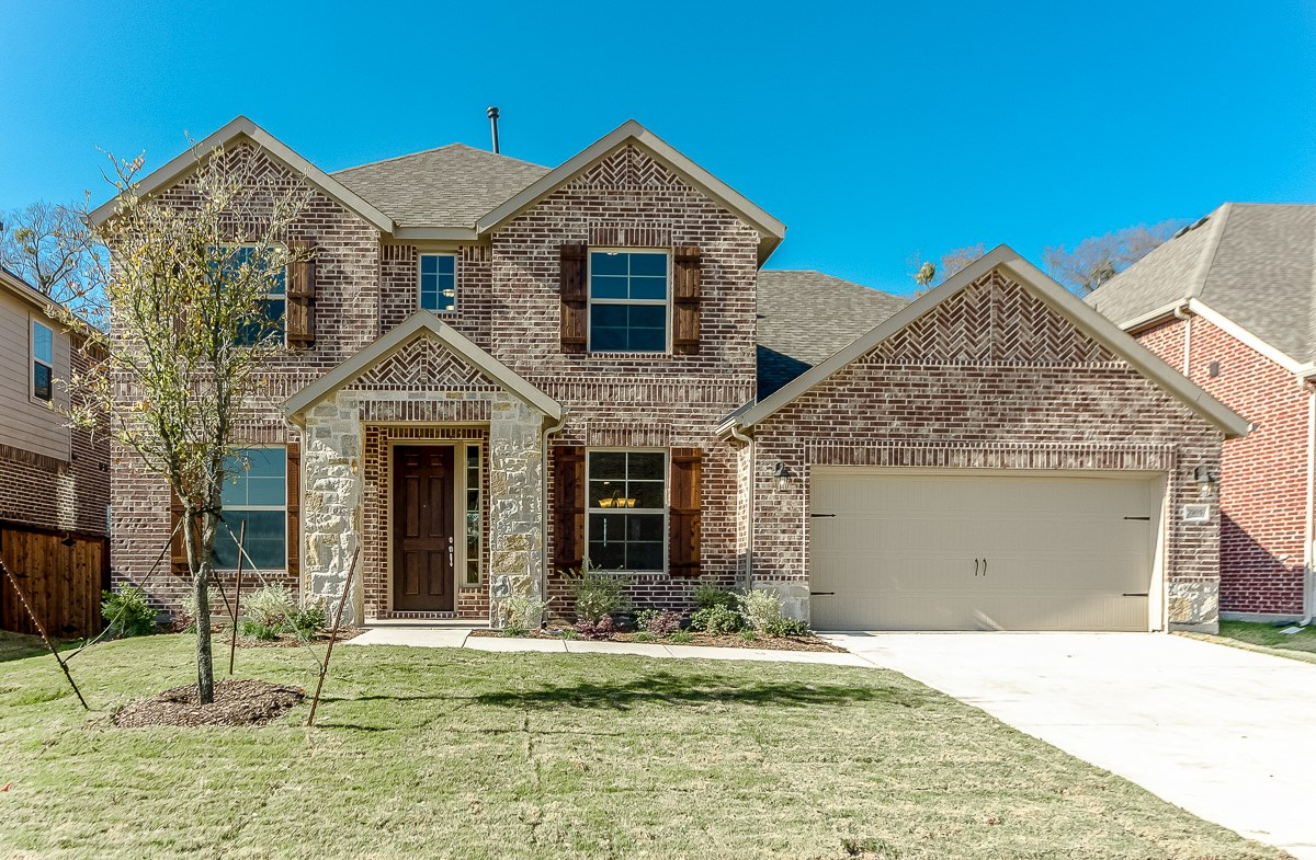 Gruene TRL quick move-in Gruene with stone and brick elevation