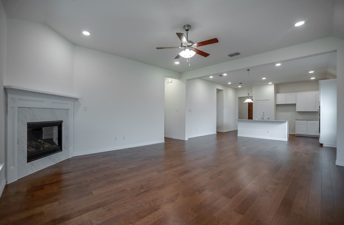 Silverado quick move-in open great room with fireplace and wood floors