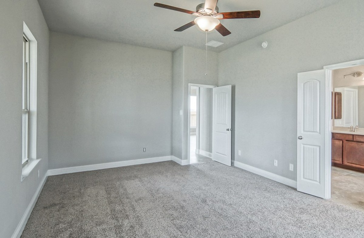 Capri quick move-in master bedroom with ceiling fan and carpet flooring