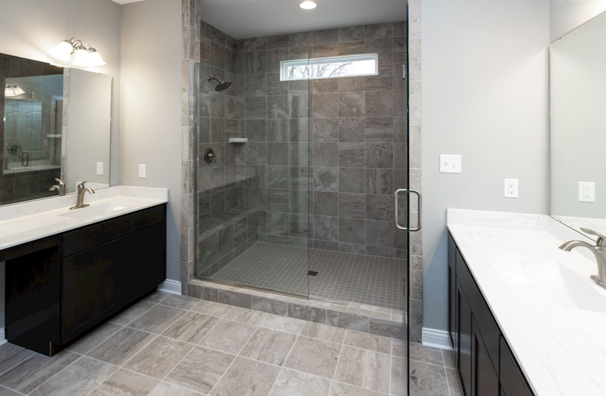 Charleston quick move-in master bath with dual sinks and spa shower