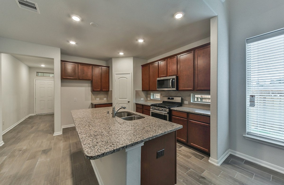 Franklin quick move-in kitchen with granite countertops, tile flooring and stainless steel appliances