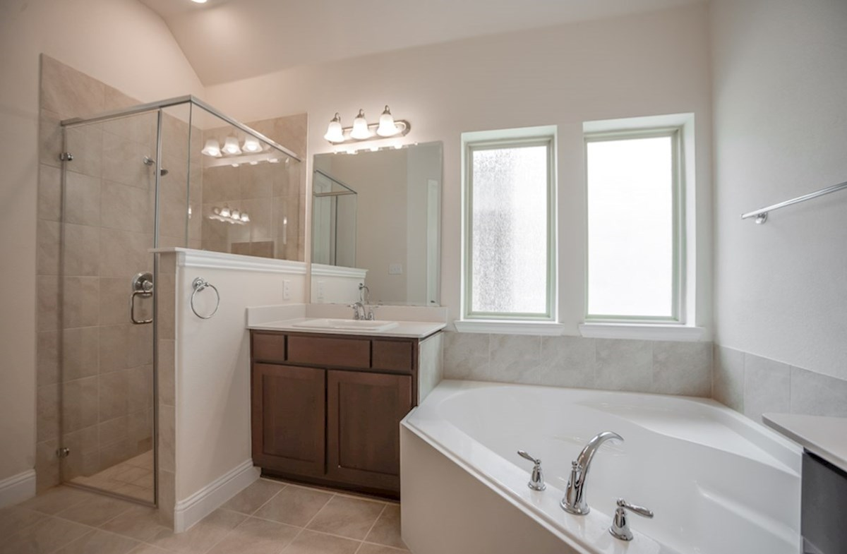 Silverado quick move-in master bathroom with separate vanities, soaking tub and shower