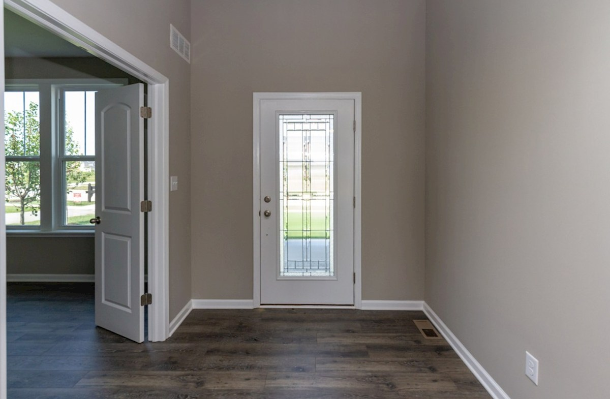 Porter quick move-in Welcoming foyer with hardwood floors