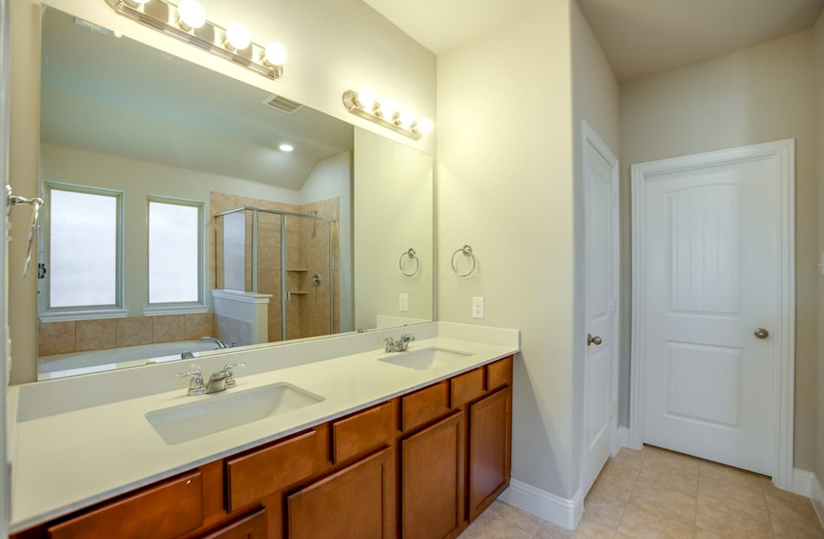 Sutton Fields Baxter Baxter master bathroom with double vanities
