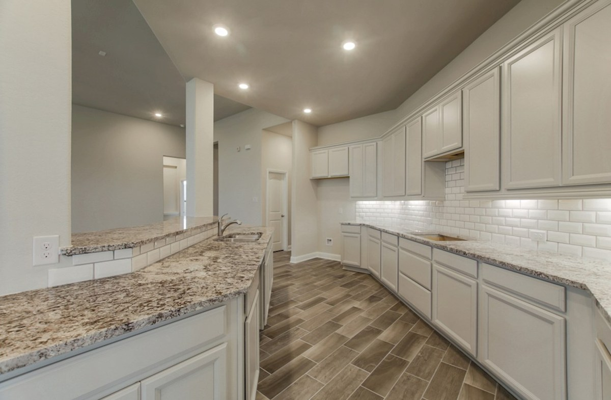 Fredericksburg quick move-in kitchen with granite countertops and spacious cabinets