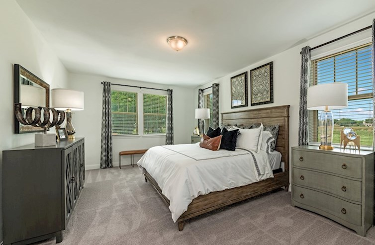 Sherwood light-filled master bedroom with plush carpet