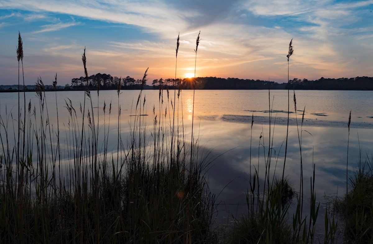Catch a beautiful sunset at Assawoman Bay