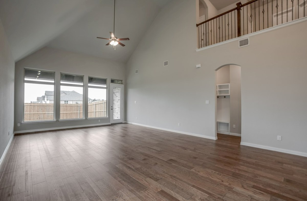 Brighton quick move-in open great room with tall windows and ceiling fan