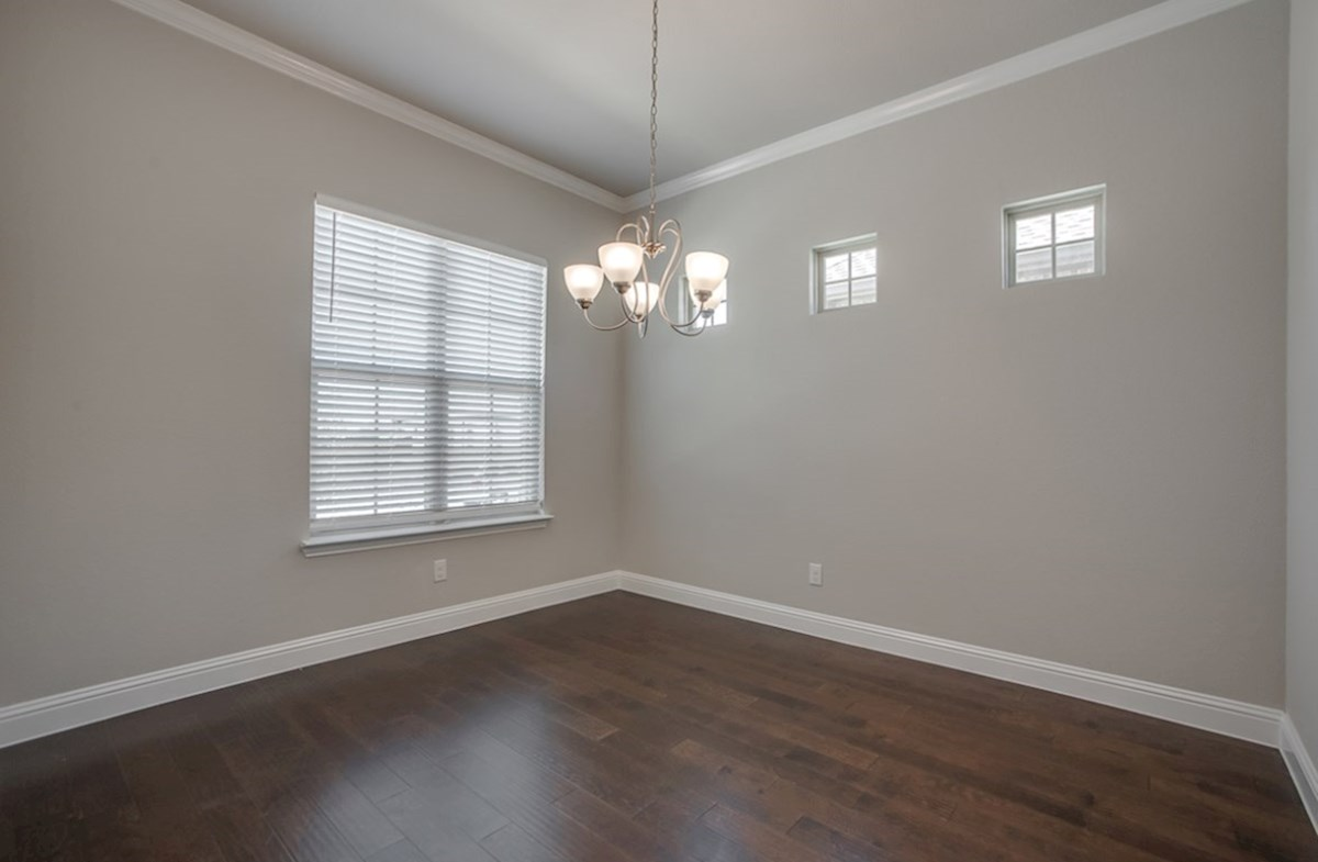 Eastland quick move-in open dining room with high accent windows