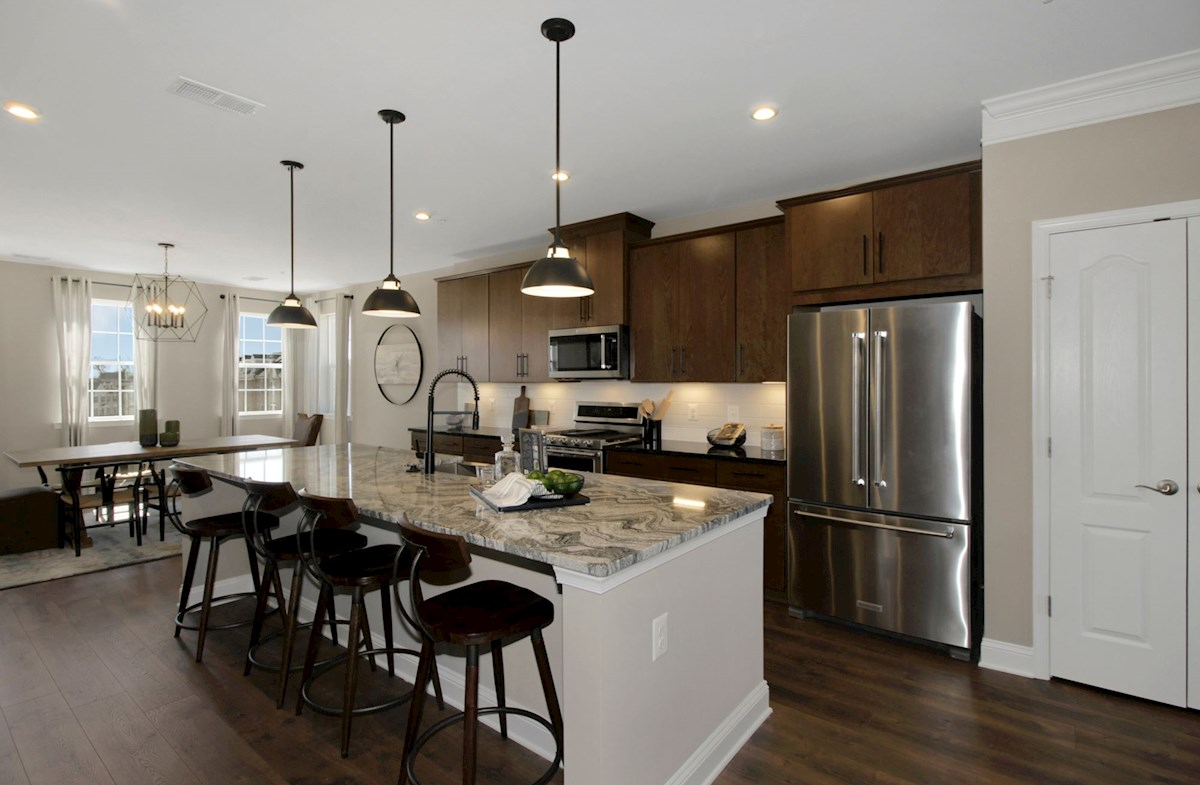 kitchen with granite & stainless steel appliances