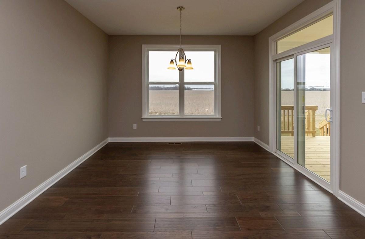 Capitol quick move-in breakfast area with hardwood floors