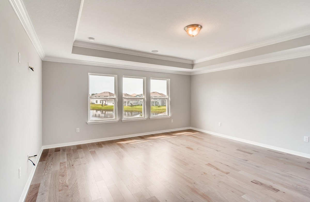 Sequoia quick move-in Master Bedroom with tray ceiling and engineered hardwood floors