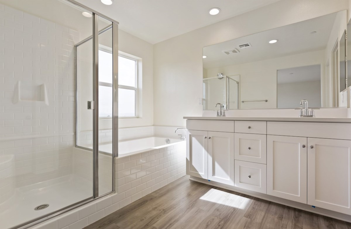 Paxton quick move-in Spa-inspired luxury abounds in the deluxe master bath, complete with separate shower and soaking tub