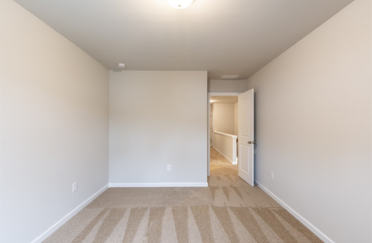 Rabun quick move-in Secondary bedroom with carpet