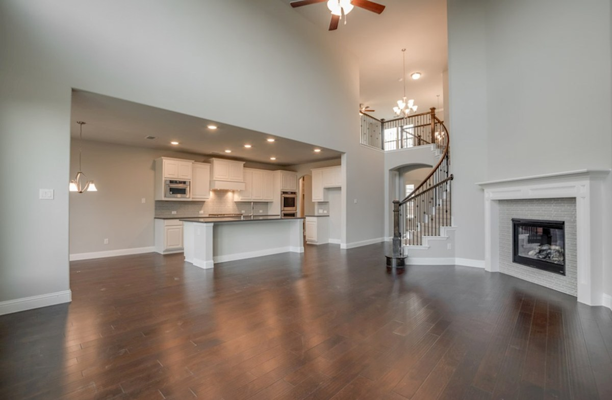 Madison quick move-in Madison great room with grand staircase and fireplace