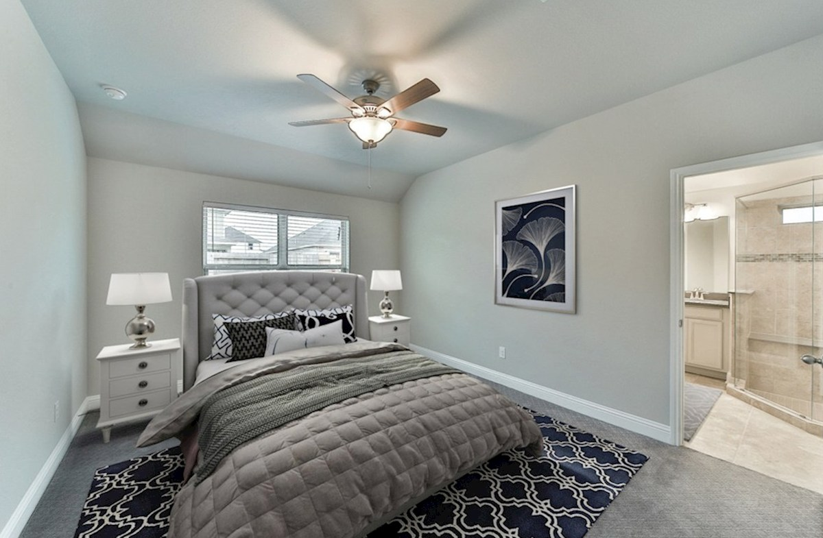 Young Ranch Anderson master bedroom with carpet and ceiling fan