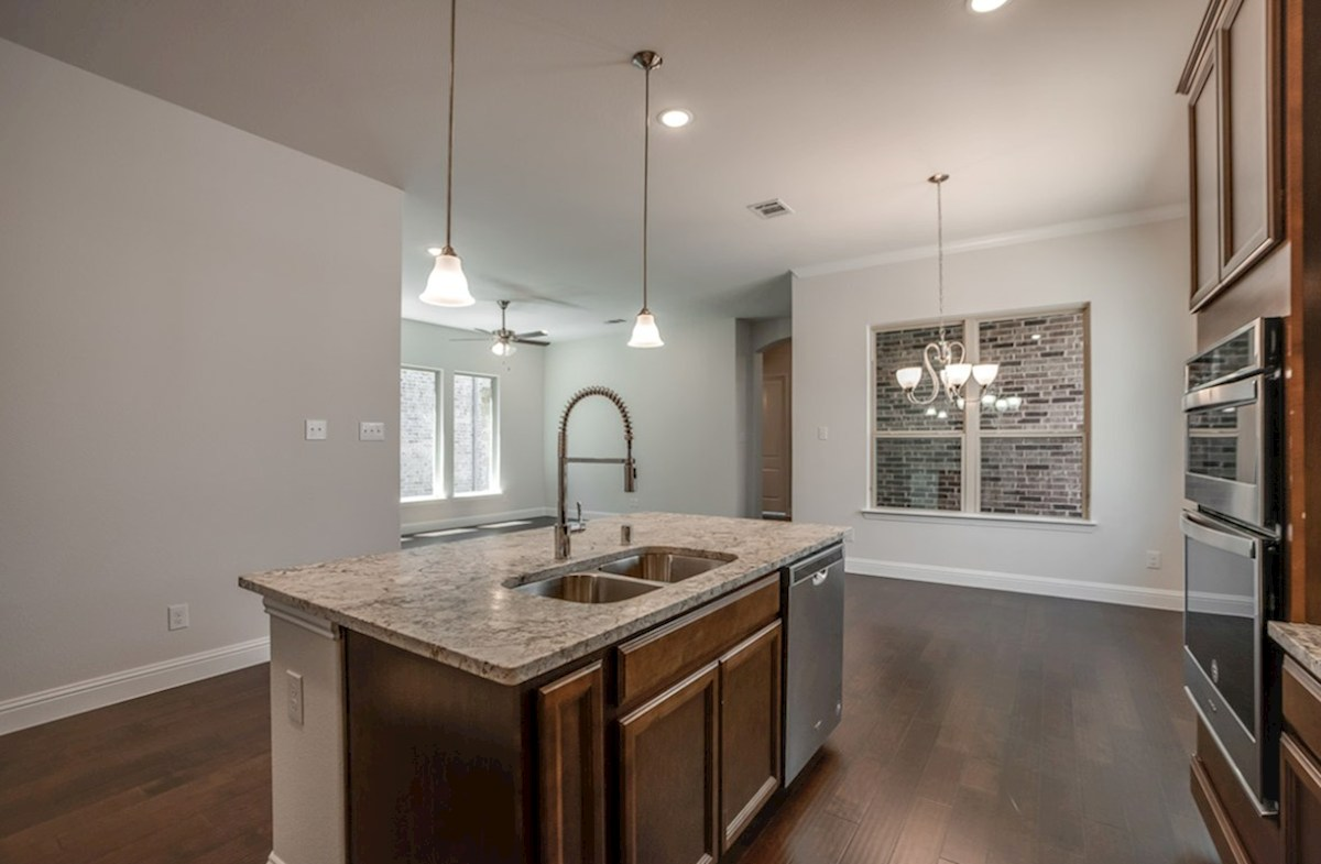 Wimberley quick move-in open kitchen with large island that opens to breakfast room