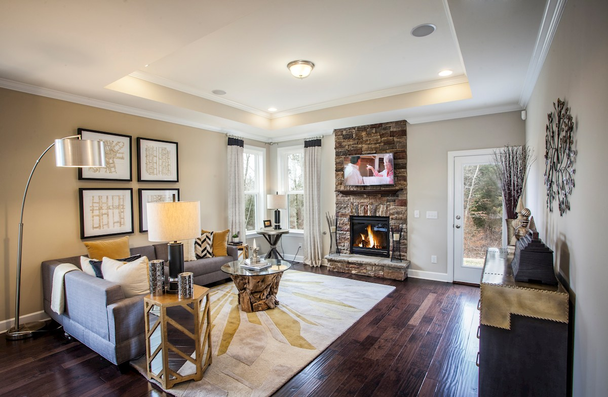 Magnolia Farms Oxford great room with floor to ceiling stone fireplace
