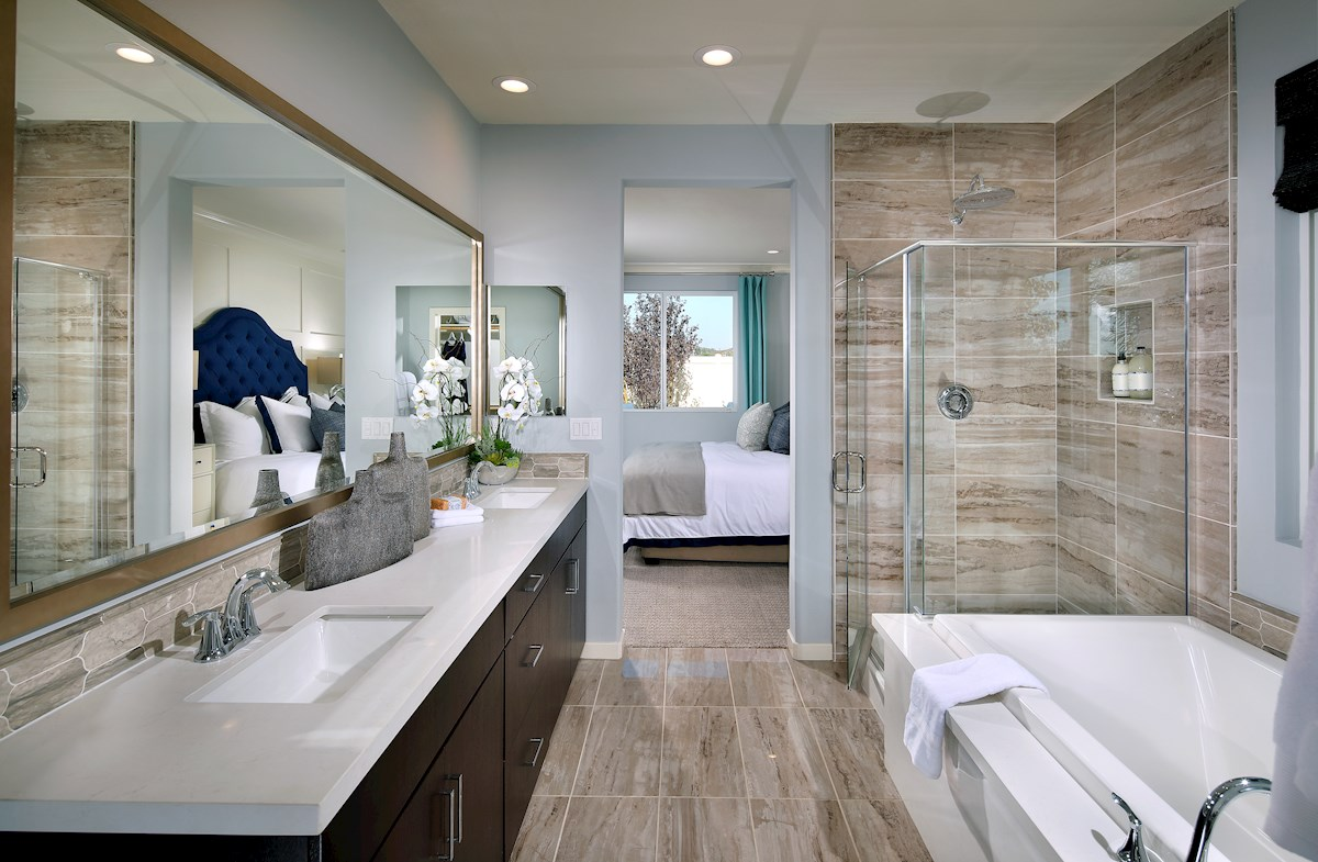 Master bath with separate shower and soaking tub.