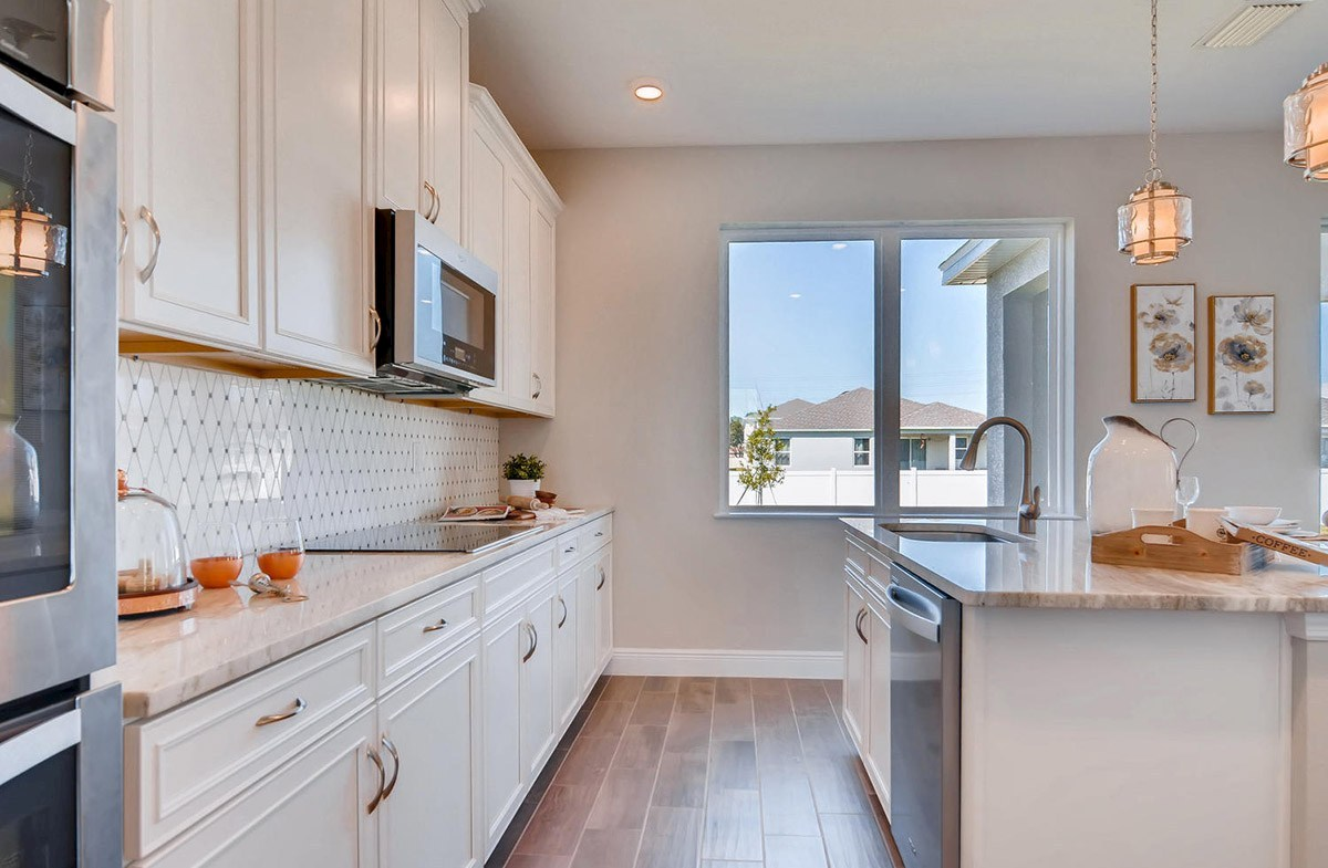 Reserve at Citrus Park Sand Dollar Open kitchen with a large island
