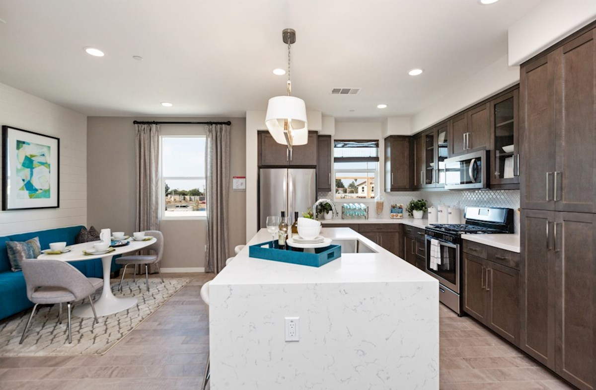 Orchid quick move-in enjoy casual dining in open-concept kitchen