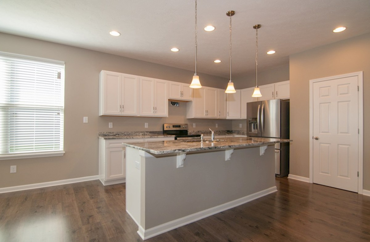 Summerland Park Hamilton  kitchen with quartz countertops and breakfast bar