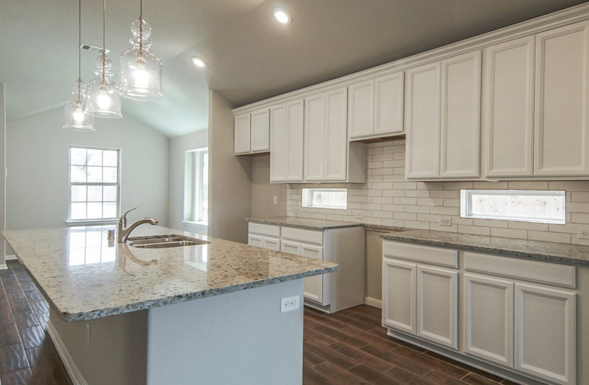 Hickory quick move-in open kitchen with granite island and modern light fixtures