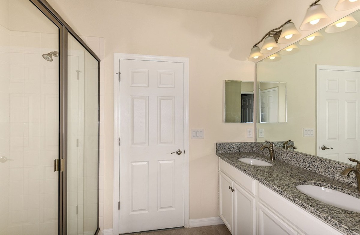 Siesta Key quick move-in Master bath features dual vanity and glass enclosed walk-in shower