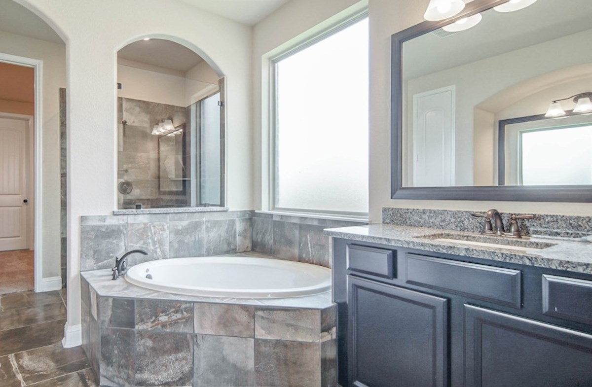 Lockhart quick move-in master bathroom with separate tub and shower