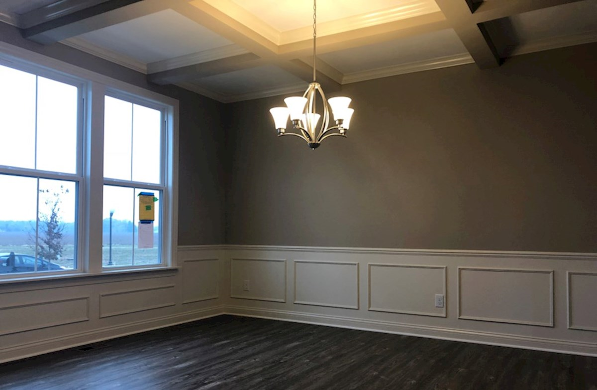 Oakhill quick move-in Formal dining room with coffered ceiling