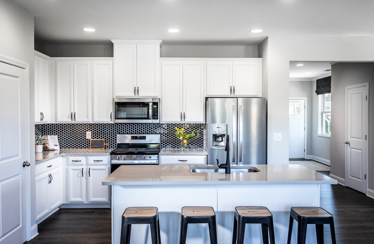 kitchen with large center island & white cabinetry