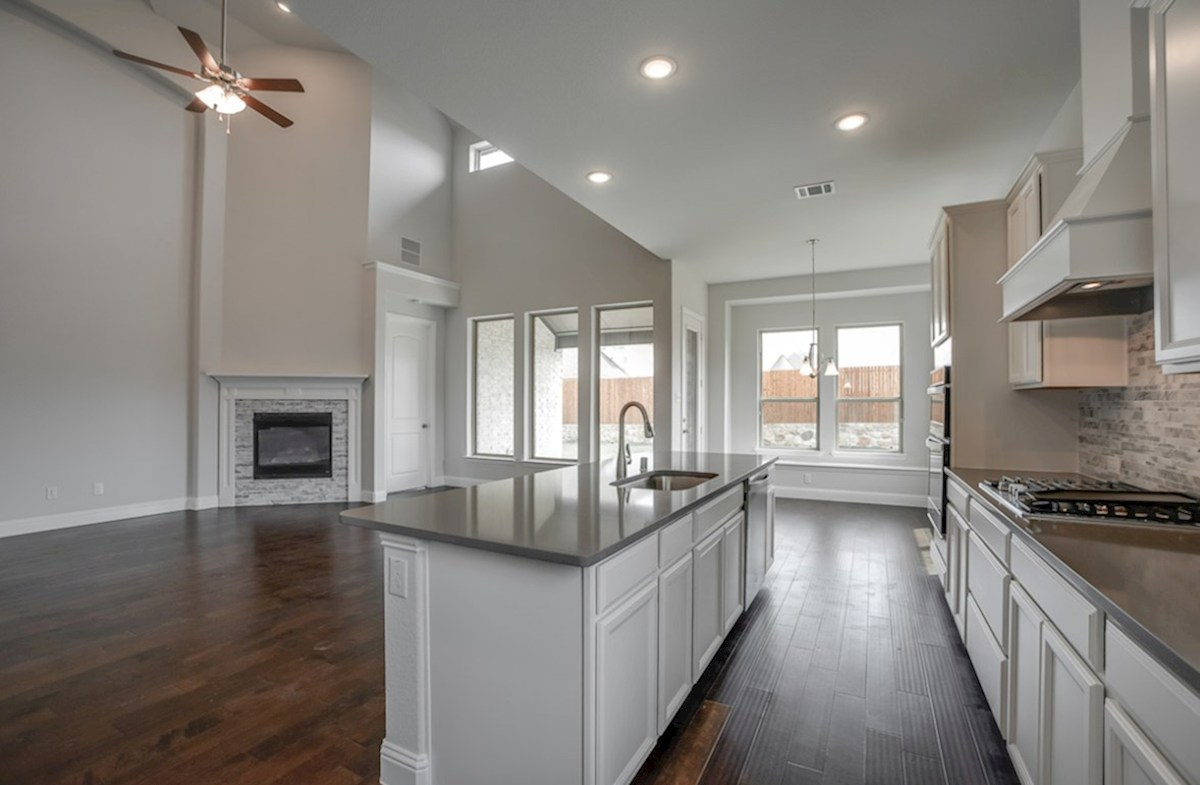Summerfield quick move-in open kitchen with large island that opens to great room