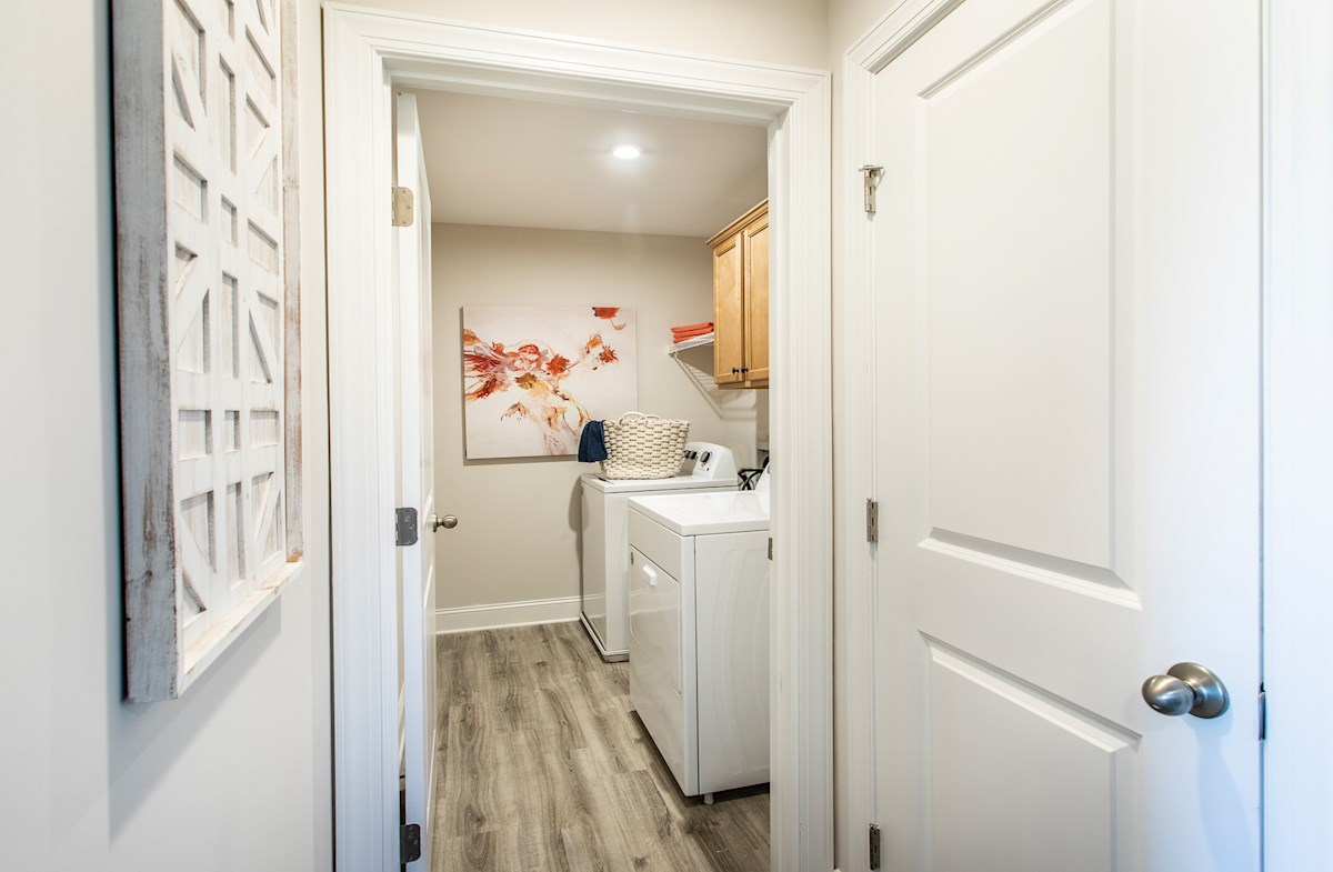 Laundry room with upper cabinets