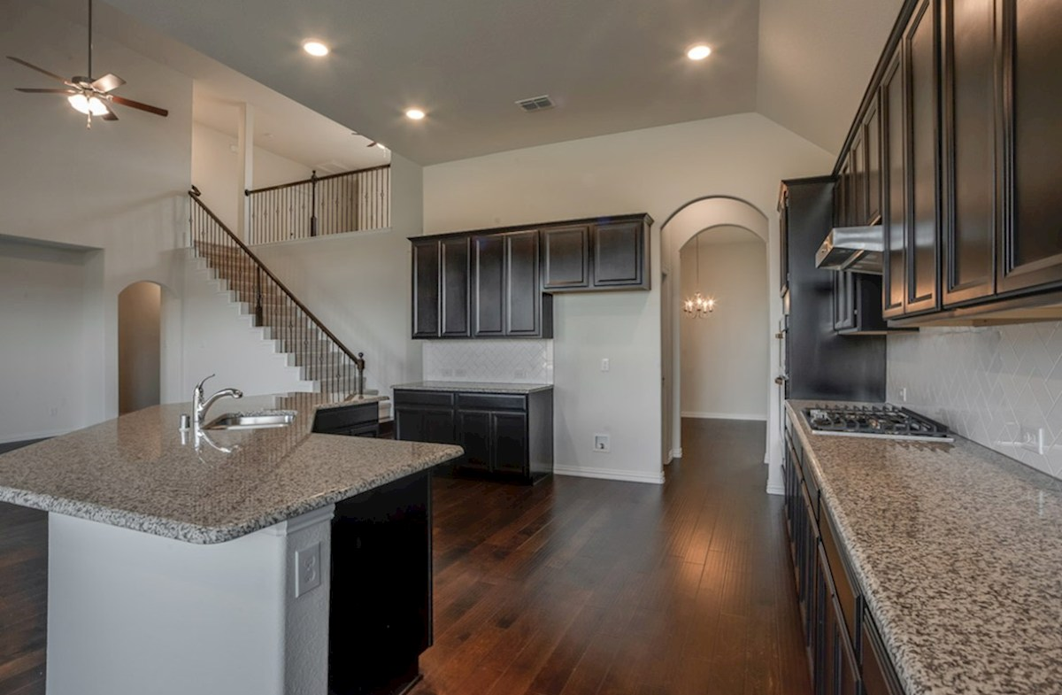 Kerrville quick move-in kitchen features wood flooring