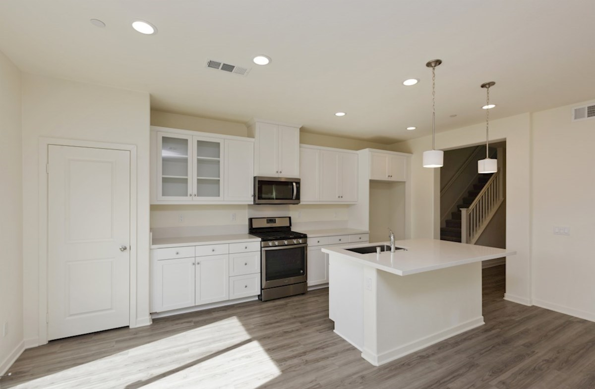 Paxton quick move-in The kitchen features spacious countertops and a walk-in pantry to maximize storage