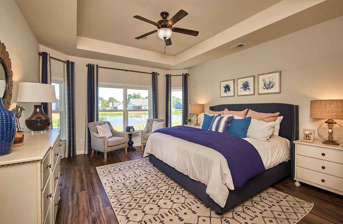 Surfside Plantation Windsor master bedroom features bay windows