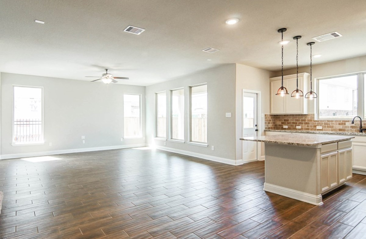 Juniper quick move-in  great room with tall ceilings and tile floors