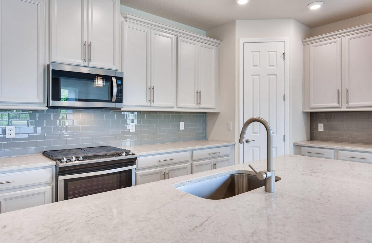 """Bayview quick move-in Kitchen with quartz countertops and 42"""" cabinets"""
